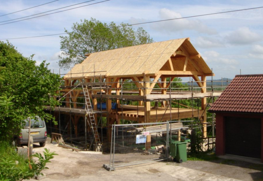 Somerset timber framed home with straw bale walls rendered in lime; straw bale house